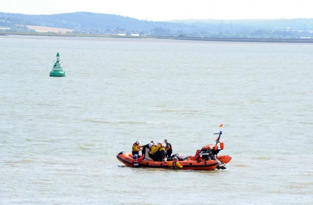 Huge emergency operation rescues man trapped in mud in the sea